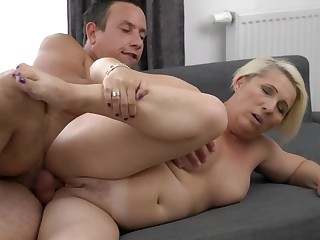 A granny with a fat aggravation is doing a blow job in a sexy manner