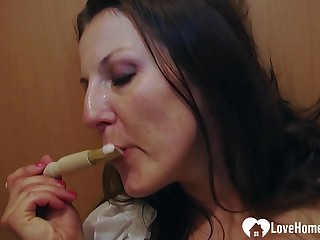 Hot dark hair uses a toy while masturbating