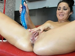 Squirting latina fisting with an increment of toying her pussy