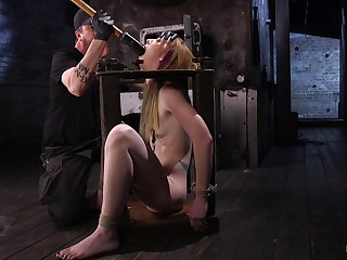 Tied up blonde Katy Kiss fucked with a fuck requisites with an increment of wants more