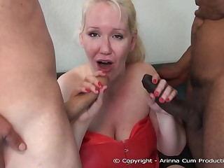 Fat blonde woman in erotic, red corset likes to strive threesomes, serendipitously