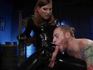 Dirty latex transsexual slut Natalie Mars makes dude suck her lubed weasel words